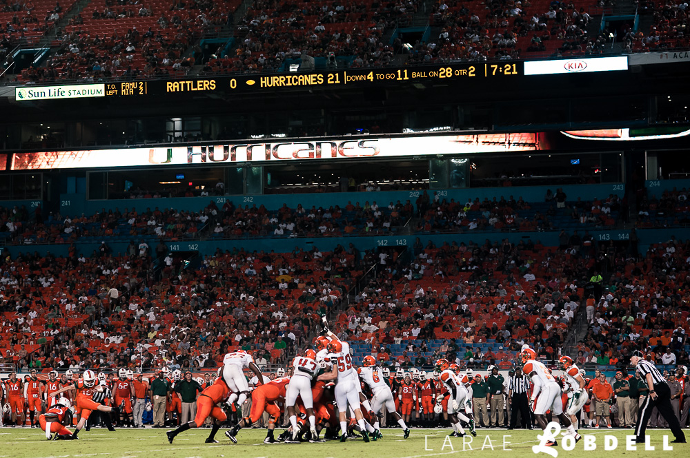 The University of Miami hosts Florida A&M University at Sun Life Stadium in Miami Gardens on Saturday, September 6, 2014. © LaRae Lobdell |Camera: Nikon D700 with 85/1.8 lens