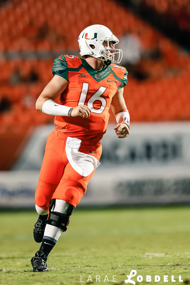 University of Miami Hurricanes quarterback Jake Heaps (16) in the fourth quarter as the University of Miami hosts Florida A&M University at Sun Life Stadium in Miami Gardens on Saturday, September 6, 2014. © LaRae Lobdell Camera: Canon 400/2.8 on an EOS-1D X