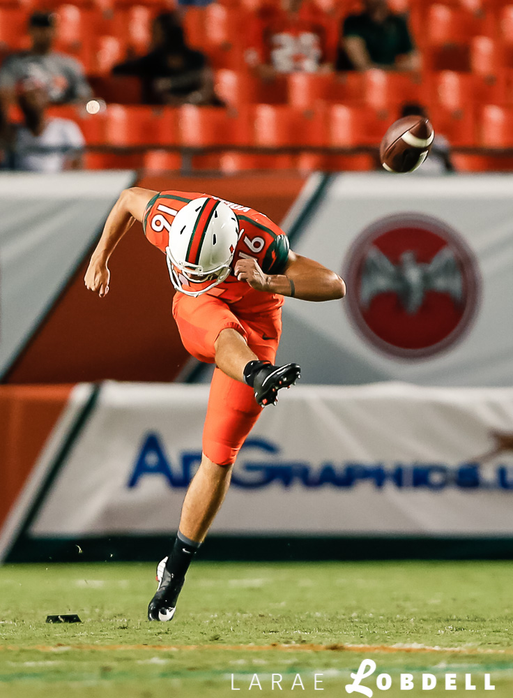 University of Miami Hurricanes kickoff specialist Justin Vogel (16) punts to the Florida Rattlers in the fourth quater as the University of Miami hosts Florida A&M University at Sun Life Stadium in Miami Gardens on Saturday, September 6, 2014. © LaRae Lobdell Camera: Nikon D700 with 85mm 1.8