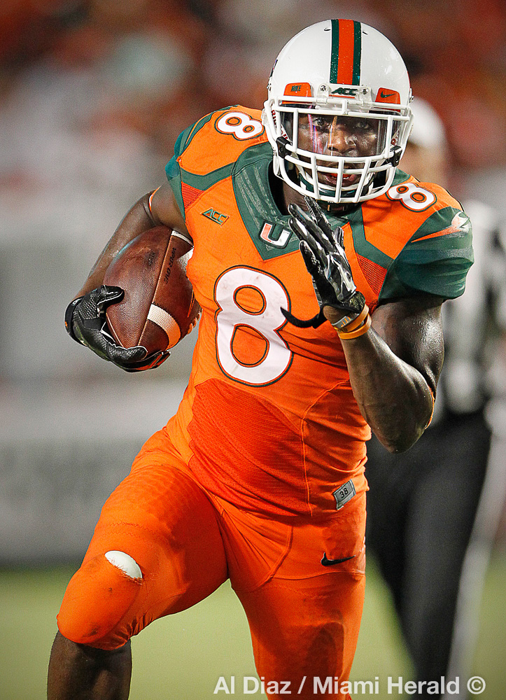 University of Miami Hurricanes running back Duke Johnson (8) runs for yardage in the second quarter as the University of Miami hosts Florida A&M University at Sun Life Stadium in Miami Gardens on Saturday, September 6, 2014.© Al Diaz / Miami Herald