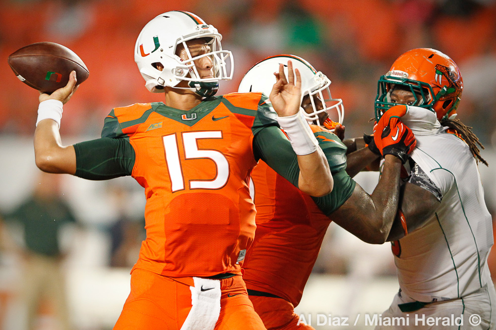 University of Miami Hurricanes quarterback Brad Kaaya (15) sets up to pass in the second quarter as the University of Miami hosts Florida A&M University at Sun Life Stadium in Miami Gardens on Saturday, September 6, 2014.© Al Diaz / Miami Herald