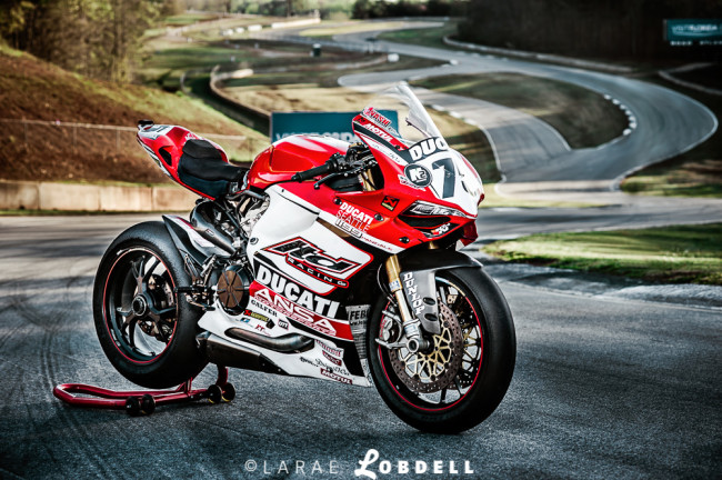 The Ducati 1199 Panigale built by master tech Jon Schiereck sitting on the track in front of the infamous S Curves at Road Atlanta in Braselton, GA.