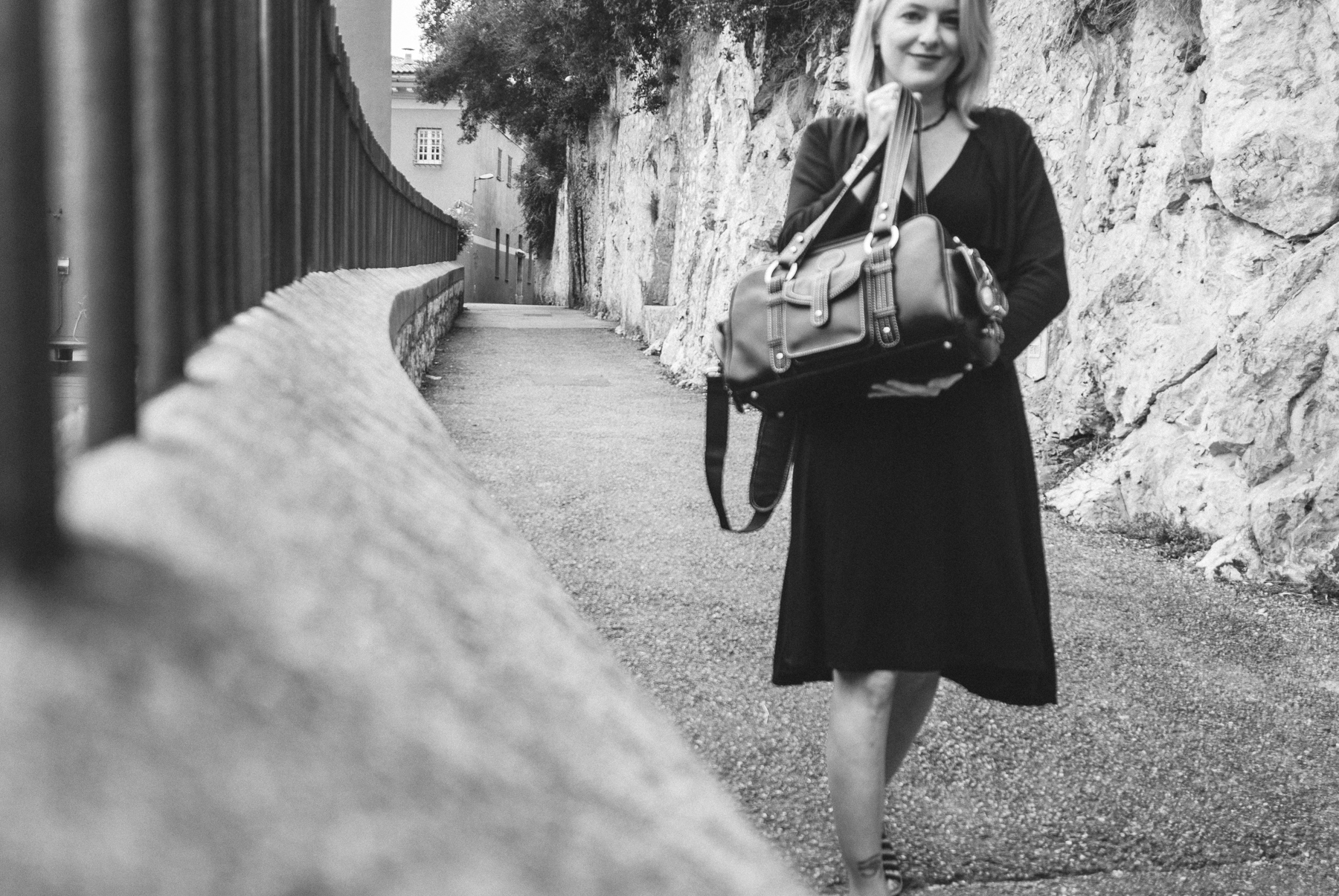 Photographer LaRae Lobdell using Jill-e Designs camera bag in Villefranche-sur-Mer outside of Nice on the French Riviera, October 8, 2010.