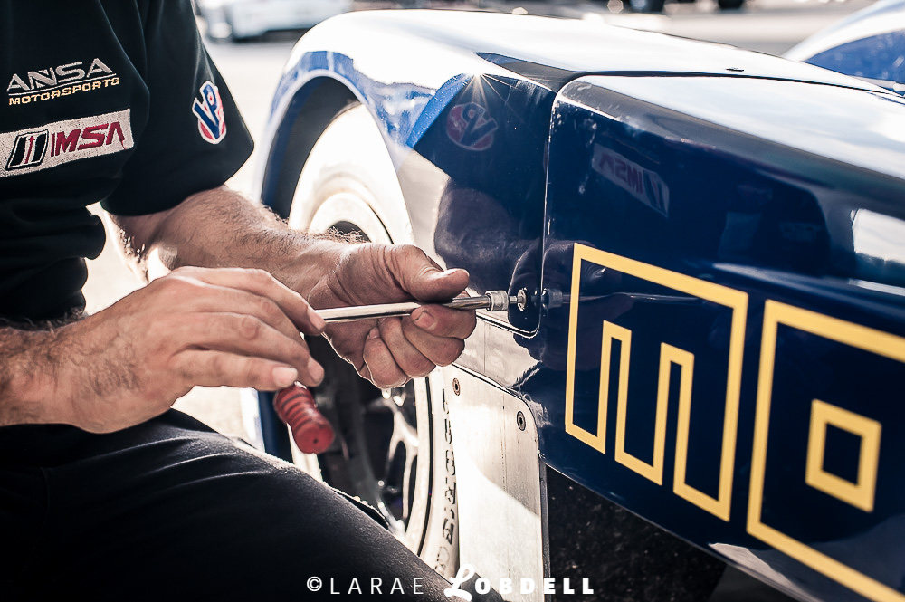 ANSA Motorsports technician working on the IMSA / Cooper Tires Prototype Lite at Homestead-Miami Speedway.
